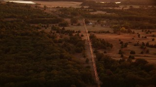 HDA12_157 - 1080 stock footage aerial video of a home and power lines at sunset in Texas