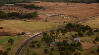 HDA12_169 - 1080 stock footage aerial video of flying over Highway 380 through Decatur, Texas, sunset