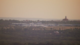 HDA12_170 - 1080 aerial stock footage video of a factory at sunset in Decatur, Texas