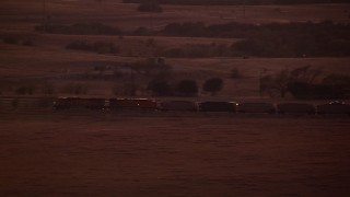 HDA12_180 - 1080 stock footage aerial video of a train passing through countryside at night in Decatur, Texas