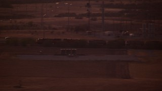 HDA12_181 - 1080 stock footage aerial video of a train running through the countryside at night in Decatur, Texas