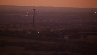 HDA12_182 - 1080 stock footage aerial video of a train passing through farmland at night in Decatur, Texas