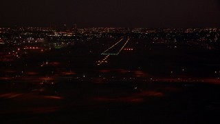 HDA12_186 - 1080 stock footage aerial video approach the Fort Worth Meacham International Airport runway at night, Texas