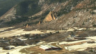 HDA13_285 - HD stock footage aerial video of approaching rural homes at the base of Rocky Mountains, Colorado
