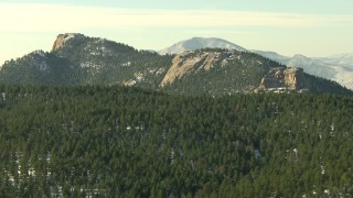 HDA13_287 - HD stock footage aerial video of flying by Rocky Mountains with forest and snow in Colorado