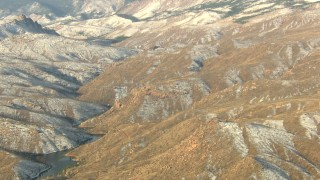 HDA13_293 - HD stock footage aerial video tilt up slopes to top of ridge in the Rocky Mountains, Colorado