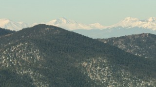 HDA13_302 - HD stock footage aerial video of mountains with trees and light snow in the Rocky Mountains, Colorado