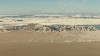 HDA13_307 - HD stock footage aerial video of Spinney Mountains with snow and lake in Park County, Colorado