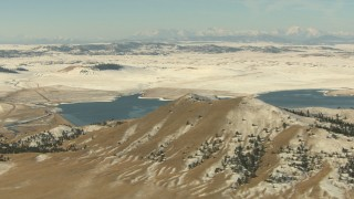 HDA13_309 - HD stock footage aerial video of mountains with light snow and a lake in Park County, Colorado