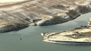 HDA13_313 - HD stock footage aerial video of a boat sailing a lake in Park County, Colorado