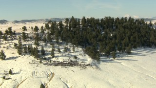 HDA13_316 - HD stock footage aerial video approach and fly over snowy hill in Park County, Colorado