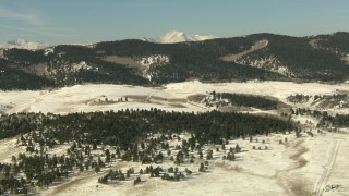 HDA13_320 - HD stock footage aerial video of flying over a snowy valley to approach Rocky Mountains, Park County, Colorado