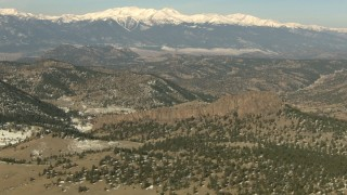 HDA13_324 - HD stock footage aerial video of hills and snow-capped Rocky Mountains, Colorado