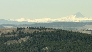 HDA13_333 - HD aerial stock footage video of snowy Rocky Mountains seen beyond a ridge, Colorado