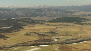 HDA13_343 - HD stock footage aerial video of approaching farms and fields in Ridgway, Colorado