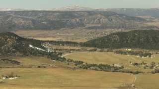 HDA13_345 - HD stock footage aerial video fly over farms toward the town of Ridgway, Colorado