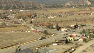 HDA13_345_02 - HD stock footage aerial video pan across a mountain ridge to reveal the small town of Ridgway, Colorado