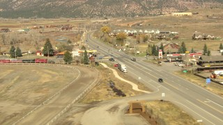 HDA13_346 - HD stock footage aerial video of flying over highway to land next to hotel in Ridgway, Colorado