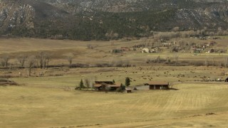 HDA13_347 - HD stock footage aerial video of grazing fields and cattle in Ridgway, Colorado