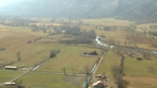 HDA13_348 - HD stock footage aerial video of flying over farms and fields near river in Ridgway, Colorado