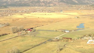 HDA13_349 - HD stock footage aerial video fly over river and farms toward the small town of Ridgway, Colorado