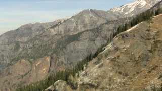 HDA13_351_01 - HD stock footage aerial video tilt up rugged slopes to reveal rugged Rocky Mountains, Colorado