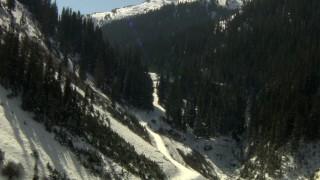 HDA13_355_03 - HD stock footage aerial video fly through a canyon between snowy Rocky Mountains, Colorado
