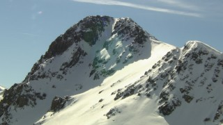 HDA13_357 - HD stock footage aerial video of orbiting a snowy peak in the Rocky Mountains, Colorado