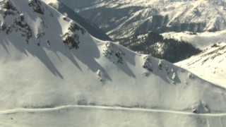 HDA13_358 - HD stock footage aerial video flyby snowy mountain ridge, Rocky Mountains, Colorado