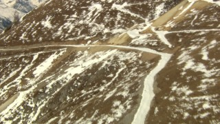 HDA13_364 - HD aerial stock footage video of following a road up a slope in the Rocky Mountains, Colorado