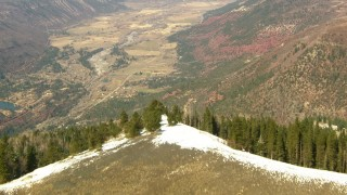 HDA13_379 - HD stock footage aerial video fly over mountain ridge toward rural valley in the Rocky Mountains, Colorado