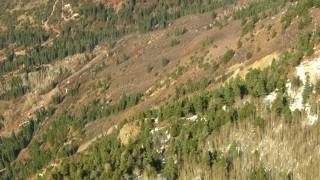 HDA13_380 - HD aerial stock footage video tilt to bird's eye view of a mountain slope, Rocky Mountains, Colorado