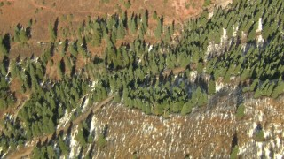 HDA13_380_01 - HD stock footage aerial video bird's eye view of mountain slopes with light snow, Rocky Mountains, California