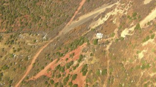 HDA13_380_02 - HD aerial stock footage video bird's eye view of a dirt road at the base of the Rocky Mountains, Colorado