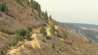 HDA13_382 - HD stock footage aerial video of a road on a mountain slopes in the Rocky Mountains, Colorado