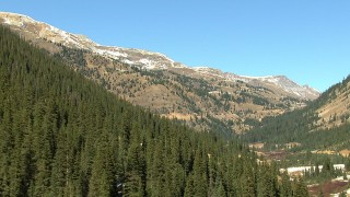 HDA13_390 - HD stock footage aerial video of snow-capped mountains and evergreens in the Rocky Mountains, Colorado