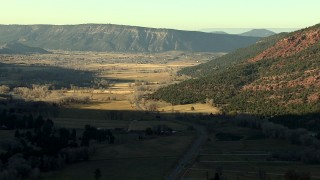 HDA13_392_01 - HD stock footage aerial video of following the road toward the town of Ridgway, Colorado at sunset