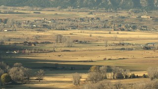 HDA13_393 - HD stock footage aerial video of grazing lands and livestock at sunset near Ridgway, Colorado