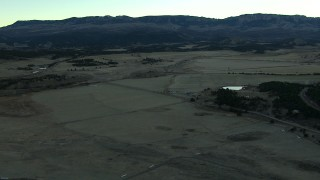 HDA13_397 - HD stock footage aerial video of flying over open fields at sunrise, Ridgway, Colorado
