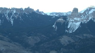 HDA13_401 - HD stock footage aerial video of flying by snowy Rocky Mountains at sunrise, Colorado