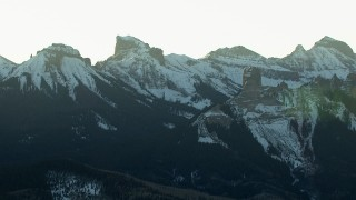 HDA13_403_02 - HD stock footage aerial video of rugged mountain peaks at sunrise, Rocky Mountains, Colorado