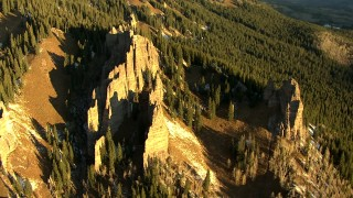 HDA13_403_05 - HD stock footage aerial video of rock formations on a mountain slope at sunrise in the Rocky Mountains, Colorado