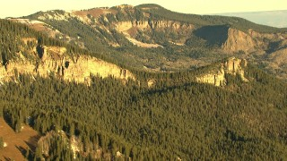 HDA13_403_06 - HD stock footage aerial video of mountain ridges and evergreen trees at sunrise in Rocky Mountains, Colorado