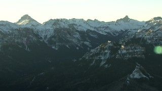 HDA13_404 - HD stock footage aerial video of snowy Rocky Mountains at sunrise, Colorado