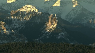 HDA13_409 - HD stock footage aerial video of steep slopes and snow in the Rocky Mountains at sunrise, Colorado
