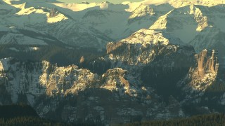 HDA13_409_01 - HD stock footage aerial video of steep and snowy mountains at sunrise, Rocky Mountains, Colorado