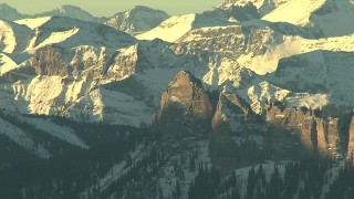 HDA13_410 - HD stock footage aerial video of jagged peaks with snow at sunrise in the Rocky Mountains, Colorado