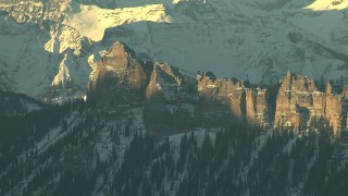 HDA13_410_01 - HD stock footage aerial video of rugged mountains with steep slopes and snow at sunrise, Rocky Mountains, Colorado