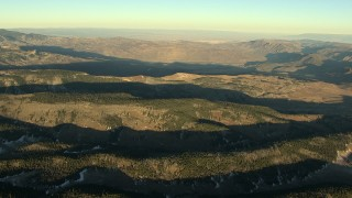 HDA13_411 - HD stock footage aerial video of rounded mountain ridges at sunrise in the Rocky Mountains, Colorado