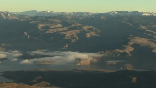 HDA13_414 - HD stock footage aerial video of the Blue Mesa Reservoir and the Rocky Mountains at sunrise, Colorado